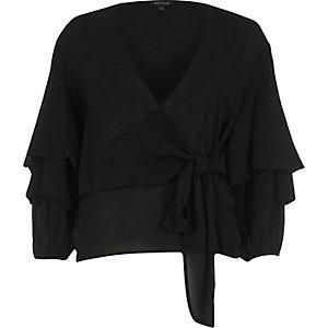 Top drapé noir à manches bouffantes noué sur le devant