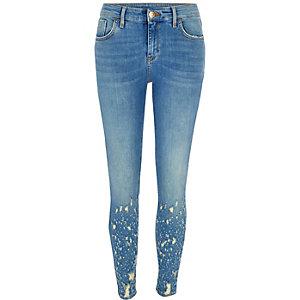 Mid blue Amelie ripped hem super skinny jeans