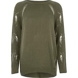 Dunkelgrüner Pullover mit Raglanärmeln