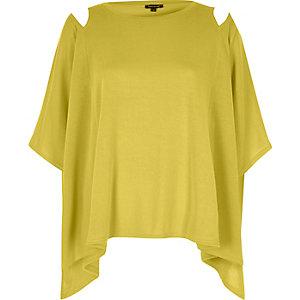 Gele capetop met uitsnede op de mouwen