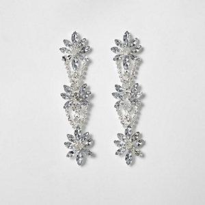 Pendants d'oreilles argentés à fleurs ornées de strass