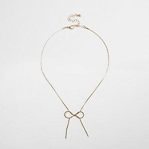 Collier doré avec nœud