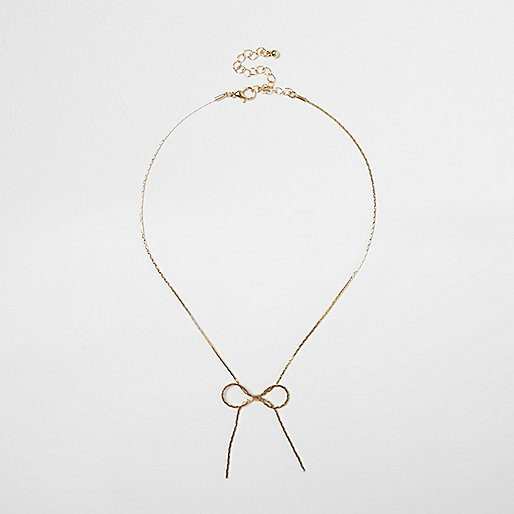 Gold tone bow necklace