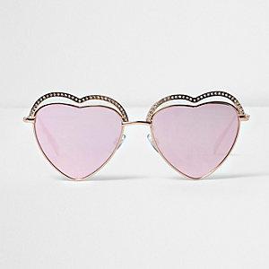 Goudkleurige hartvormige zonnebril met roze glazen