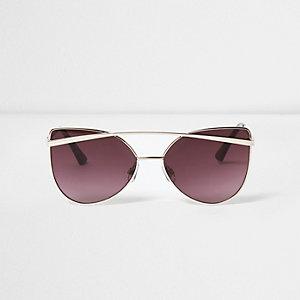 Goudkleurige cat-eye zonnebril met paarse glazen