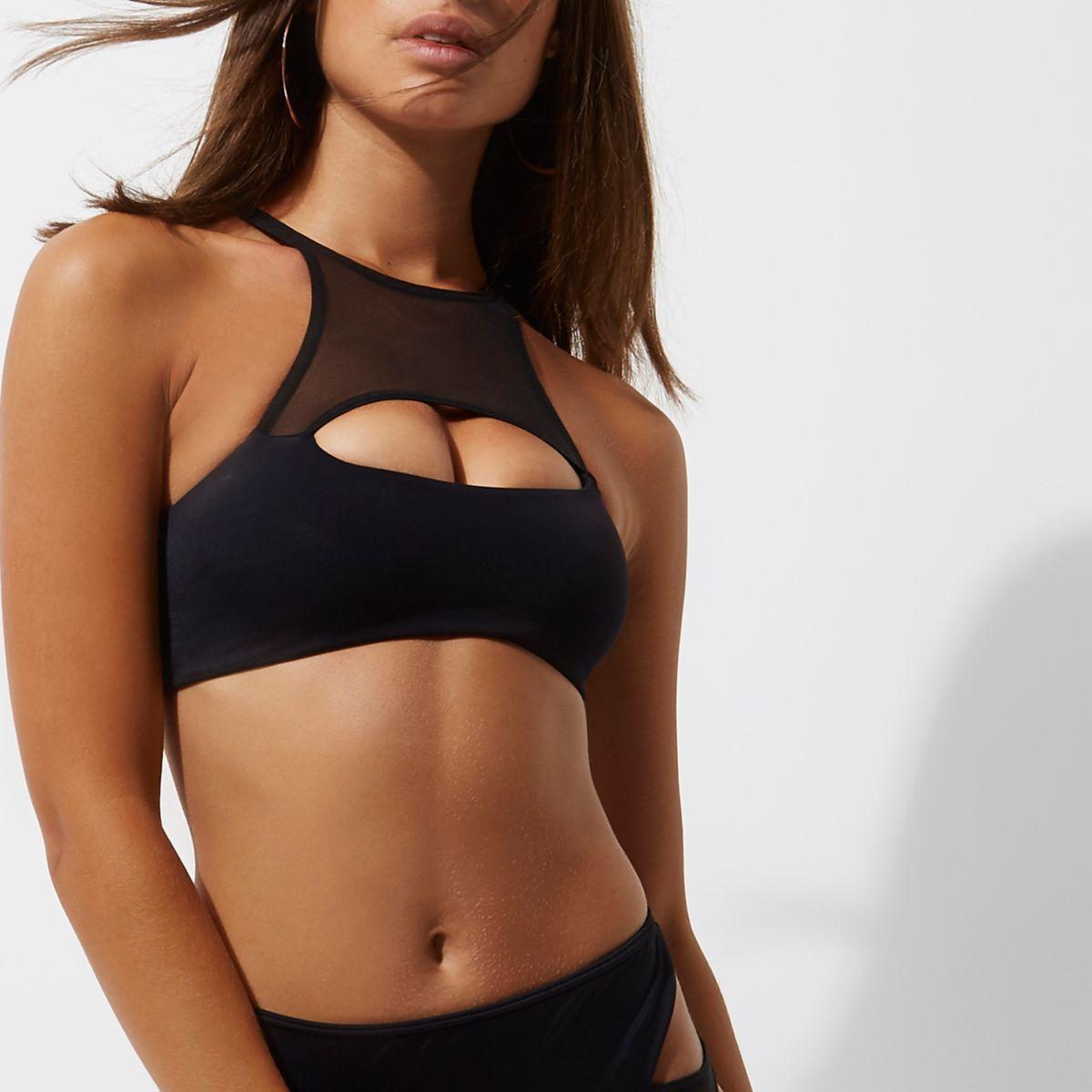 Zwarte 'kiekeboe' bikinitop met uitsneden