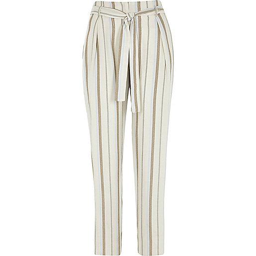 Pantalon fuselé à rayures beige avec cordon à la taille