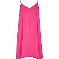 Robe rose à fines bretelles et boutons