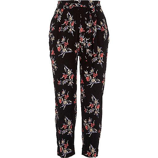 Pantalon fuselé noir à imprimé floral