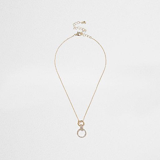 Gold tone rhinestone circle drop necklace