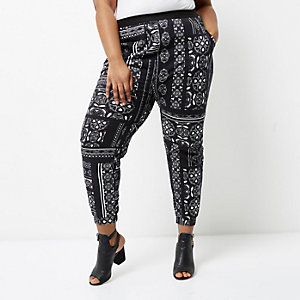 Plus black camo and floral print joggers