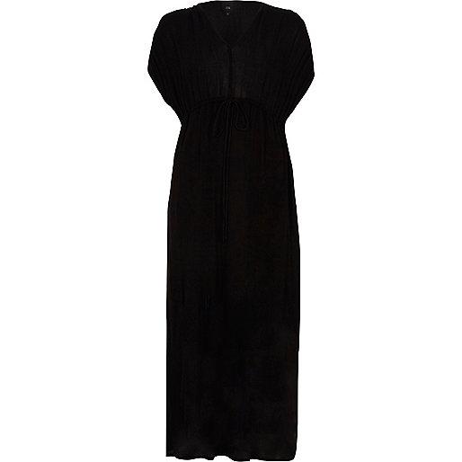 Zwarte maxi-jurk met ruches op de mouw en strikceintuur