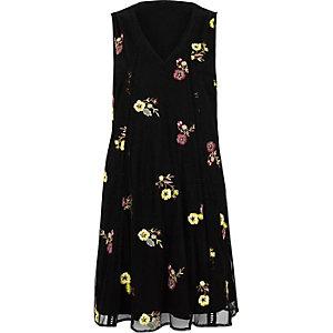 Schwarzes, geblümtes Swing-Kleid