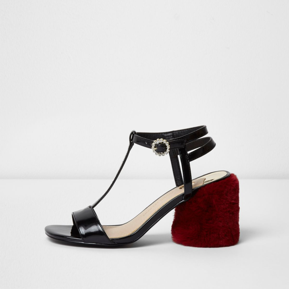 Black T-bar red faux fur block heel sandals