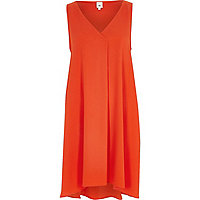 Orange sleeveless swing dress