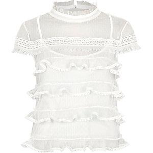 Witte top met ruches, kapmouwen en gestippeld mesh