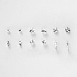 Set zilverkleurige oorbellen met studs en diamantjes
