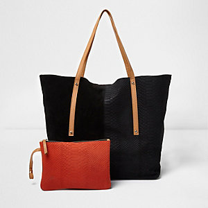 Black and tan leather winged tote bag