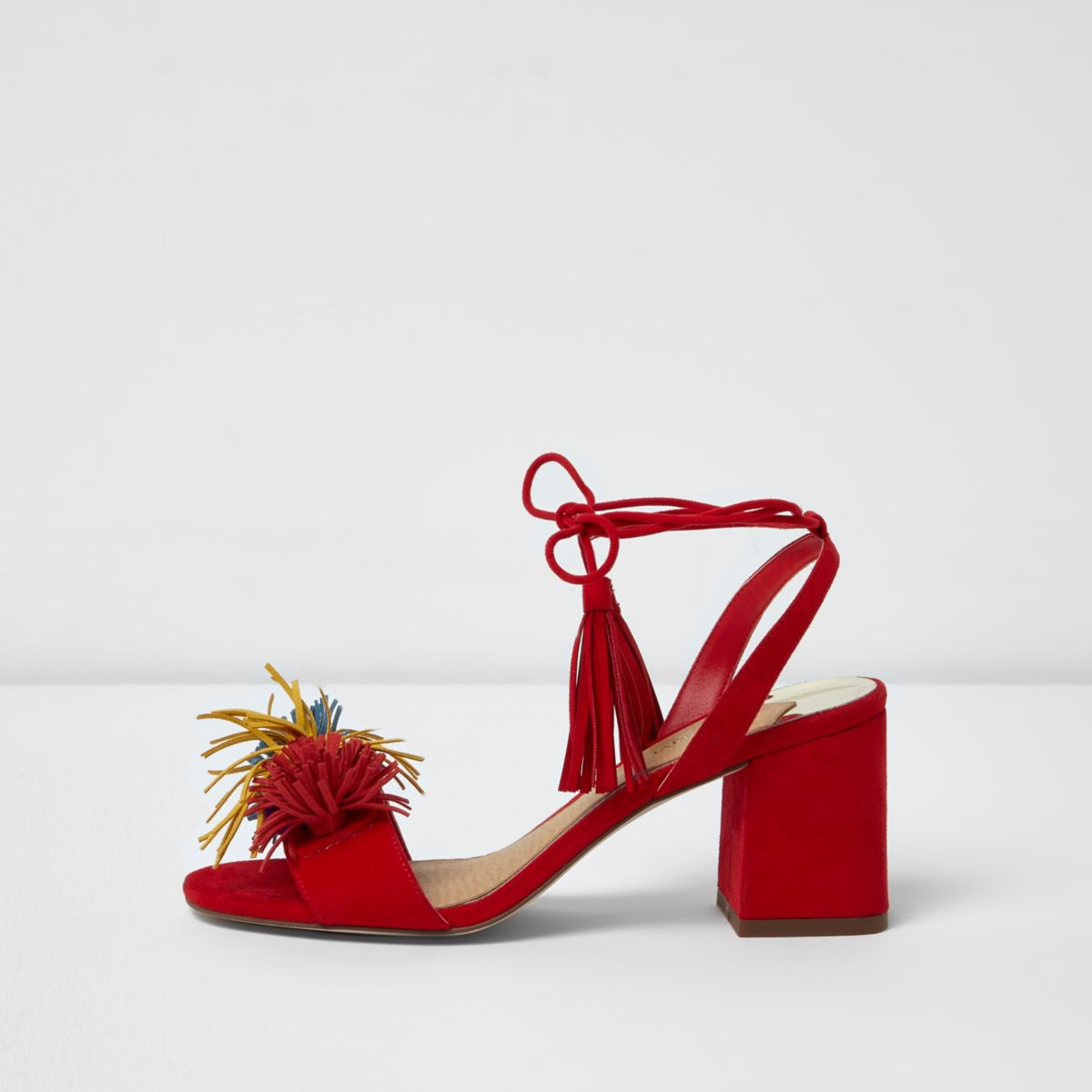 Red pom pom block heel sandals