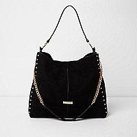 Zwarte ruimvallende oversized tas met studs en ketting