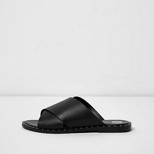 Black leather cross strap studded mules