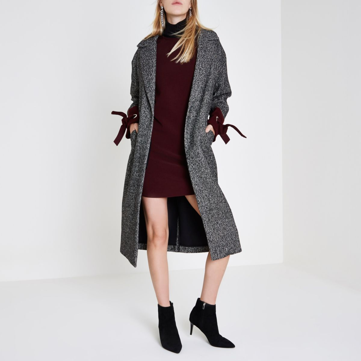 Black herringbone check tie cuff coat