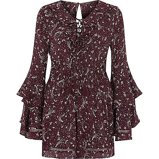 Red zodiac print lace-up front playsuit