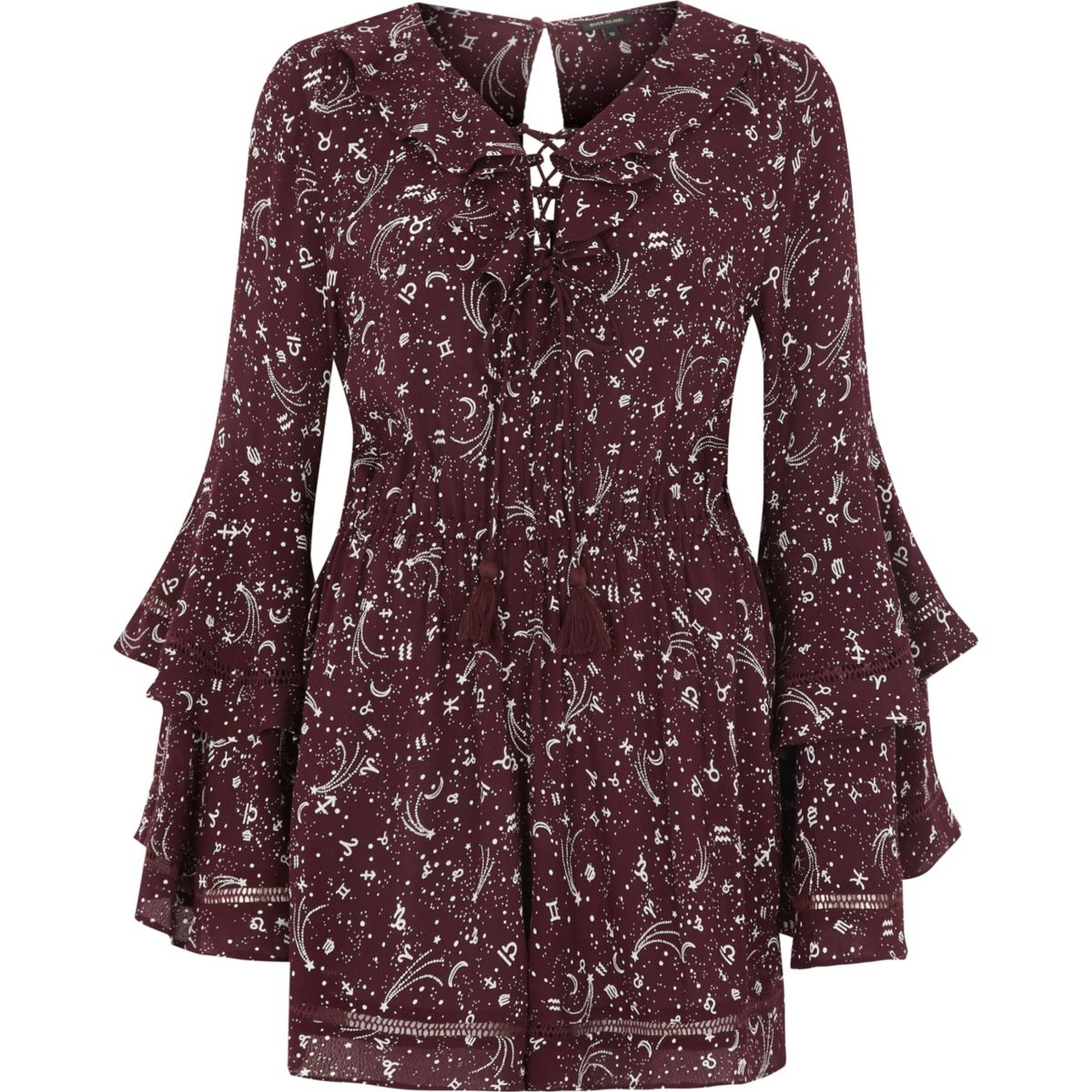 Red zodiac print lace-up front romper