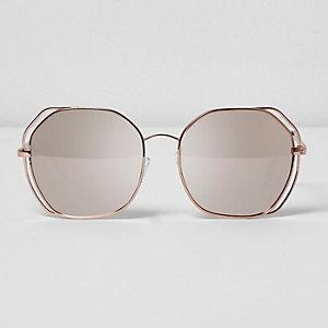 Roségoudkleurige oversized zonnebril met uitsneden