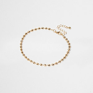 Bracelet de cheville doré en perles