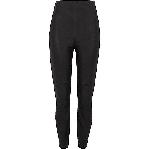 Black faux leather skinny pants