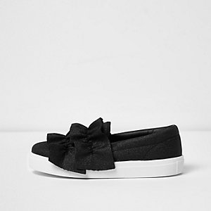Black ruffle slip on plimsolls