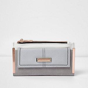 Grijze portemonnee met roségoudkleurige plaatjes