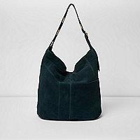Dunkelgrüne Wildledertasche mit Ösen