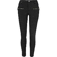 Pantalon skinny à pois noir zippé sur le devant