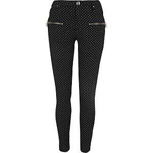 Zwarte skinny broek met stippen en rits voor