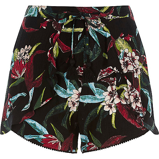 Black tropical floral print frill shorts