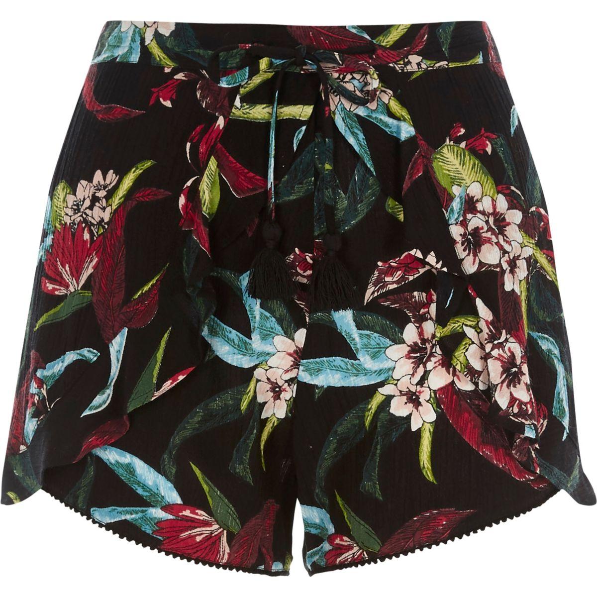 Schwarze Shorts mit tropischem Blumenprint
