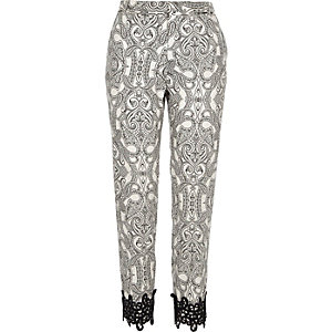 Black paisley print crochet hem trousers