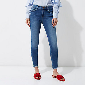 Mid blue Molly ripped hem super skinny jeans