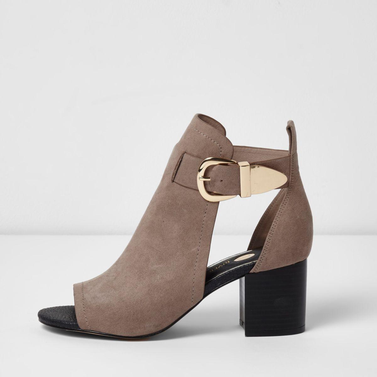 Light pink buckle block heel shoe boots