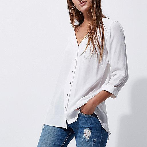 White crossover back dipped hem blouse