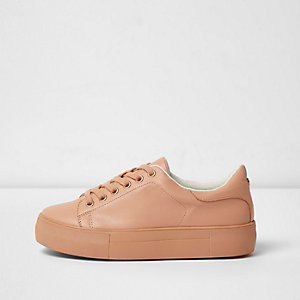 Pink lace-up flatform trainers