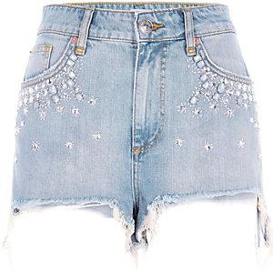Blaue, hochgeschnittene Jeansshorts mit Verzierung