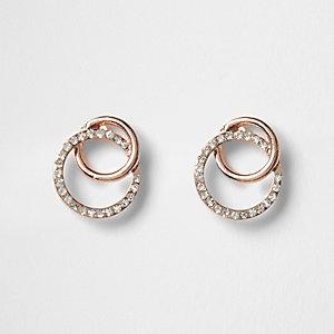 Boucles d'oreilles or rose effet entrelacé ornées de strass