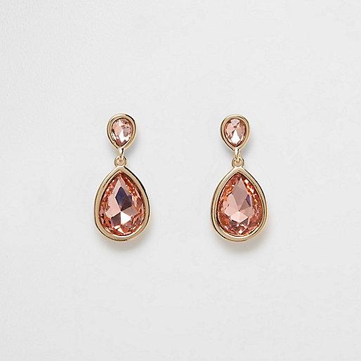 Gold tone peach teardrop dangle earrings