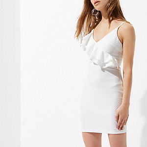 Petite white asymmetric frill bodycon dress