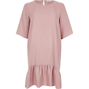 Light pink drop hem swing dress