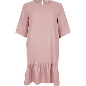 Robe trapèze rose clair à ourlet plongeant