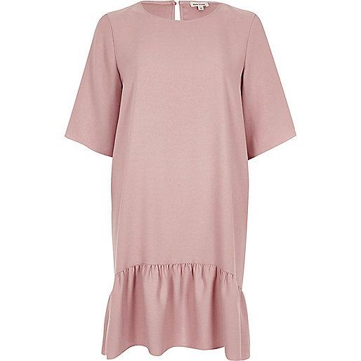 Light pink drop hem swing dress